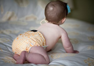My daughter at 8 months in one of my favorite cloth diapers.