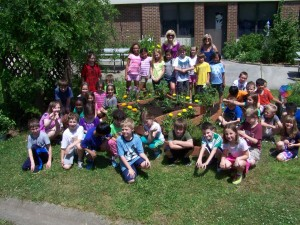 Coventry Elementary students with their monarch butterfly garden.