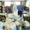 Photo Credit: Suffolk News Herald  Wayne Jones, litter control coordinator and spokesperson for Keep America Beautiful, stands at Morgan Memorial Library with some of the bags full of plastic bags that were collected during a recycling event on Saturday.