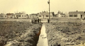 Raw sewage ran in open ditches as children played in Portsmouth's Simonsdale neighborhood in 1944, documenting the need for construction of a sanitary sewer system.