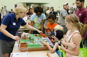 children learning at gogreen event table
