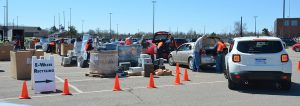 line of cars drop off electronic recycling at collections event