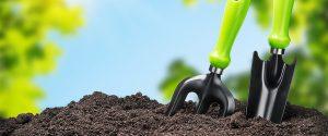 gardening tools stuck in dirt