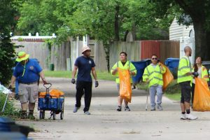6 volunteers in Virginia Beach picking up litter and laughing during a Great American Cleanup event