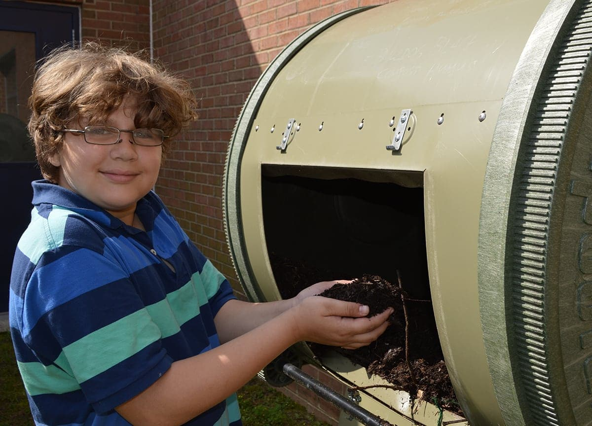 A student demonstrating their compost project